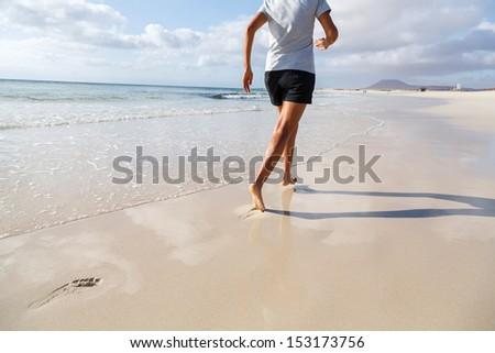 Jogging on beach - stock photo