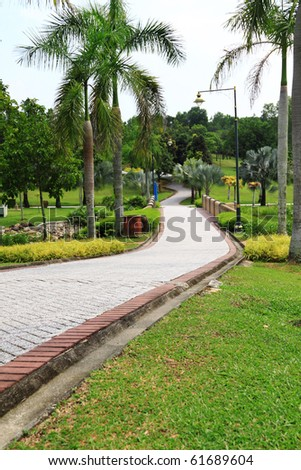 Jogging track at garden. Concept of outdoor relaxation venue. - stock photo