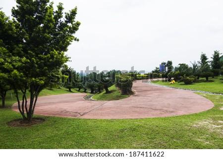 Jogging track on public park - stock photo