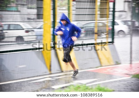 Jogging under the storm - stock photo