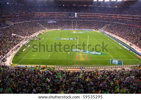 JOHANNESBURG - AUGUST 21: The largest crowd attendance at any South African Rugby game on August 21, 2010 in Johannesburg.  NZ beat SA at the FNB stadium by 29 points to 22 to win the 2010 Tri-Nations. - stock photo