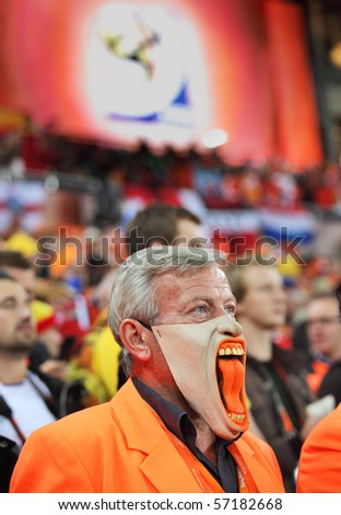 JOHANNESBURG - JULY 11 :  Final at Soccer City Stadium: Spain vs. Netherlands on July 11, 2010 in Johannesburg.  Dissapointed Dutch supporter - stock photo