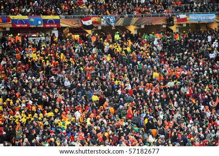 JOHANNESBURG - JULY 11 :  Final at Soccer City Stadium: Spain vs. Netherlands on July 11, 2010 in Johannesburg.  Supporters and fans - stock photo