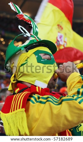 JOHANNESBURG - JULY 11 :  Final at Soccer City Stadium: Spain vs. Netherlands on July 11, 2010 in Johannesburg.  Spanish supporter with vuvuzela - stock photo