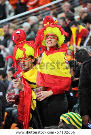 JOHANNESBURG - JULY 11 :  Final match at Soccer City Stadium: Spain vs. Netherlands.  Spanish supporters wearing costumes with octopus Paul which predicted the victory of their team - stock photo