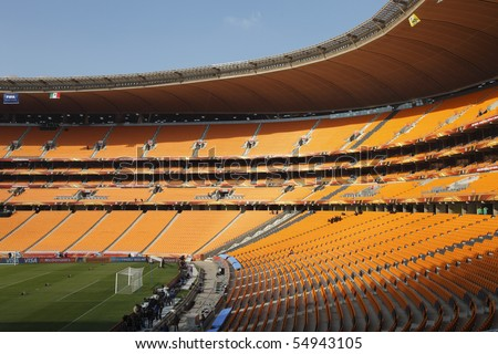 JOHANNESBURG - JUNE 10:  General view of Soccer City Stadium one day prior to the opening match of the 2010 FIFA World Cup June 10, 2010 in Johannesburg, South Africa. - stock photo