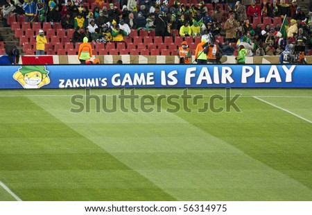 JOHANNESBURG - JUNE 20: Zakumi, the mascot of the South African 2010 Soccer World Cup is displayed on the borders of the football pitch indicating fair play at Ellis Park Stadium, South Africa on June 20, 2010