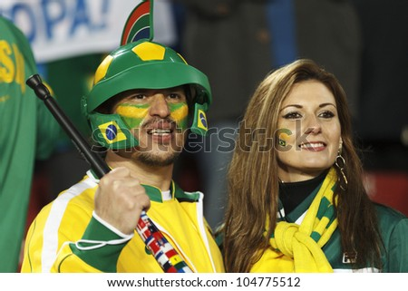 JOHANNESBURG, SOUTH AFRICA - JUNE 15:  Brazil supporters watch the action at a 2010 FIFA World Cup match June 15, 2010 in Johannesburg, South Africa.  Editorial use only. - stock photo