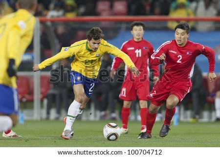 JOHANNESBURG, SOUTH AFRICA - JUNE 15:  Nilmar of Brazil on the attack against North Korea during a FIFA World Cup match June 15, 2010.  Editorial use only.  No pushing to mobile device use. - stock photo