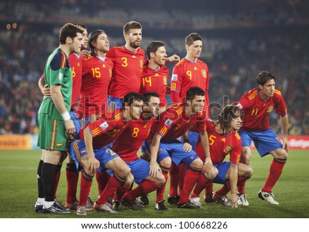 JOHANNESBURG, SOUTH AFRICA - JUNE 21:  The Spain National Team lines up before a FIFA World Cup match against Honduras June 21, 2010.  Editorial only.  No pushing to mobile device use. - stock photo