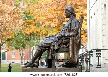 John Harvard statue at Harvard University - stock photo