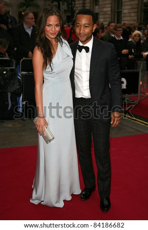 John Legend and girlfriend Christine arriving for the 2011 GQ Awards, Royal Opera House, London. 06/09/2011  Picture by: Alexandra Glen / Featureflash