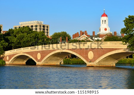 John Weeks Memorial Footbridge over the Charles River, Cambridge. White tower and red dome of Harvard University's student residence in the back.