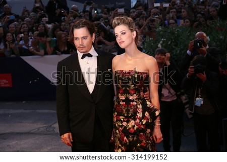 Johnny Depp and Amber Heard  attend a premiere for 'A Danish Girl' during the 72nd Venice Film Festival at on September 5, 2015 in Venice, Italy. - stock photo