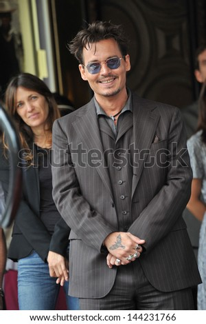 Johnny Depp on Hollywood Boulevard where Jerry Bruckheimer was honored with the 2,501st star on the Hollywood Walk of Fame. June 24, 2013  Los Angeles, CA - stock photo