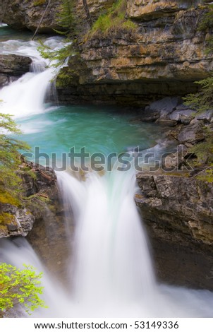 Johnston Canyon Waterfall in Banff National Park - stock photo
