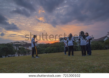 JOHOR BAHRU,MALAYSIA-SEPTEMBER 21 2017:A group of five university student have their fun time enjoy the sunset at their university