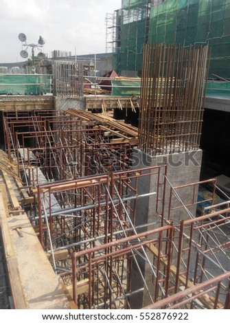 JOHOR, MALAYSIA -AUGUST 16, 2016: Concrete column steel reinforcement bar at the construction site fabricated by workers.It will be closed by timber form work before concreting work start.
