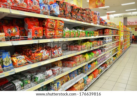 JOHOR, MALAYSIA - FEBRUARY 10, 2014: Various brands of instant noodles on the rack of supermarket. Instant noodle is one of the favorite food in Asia