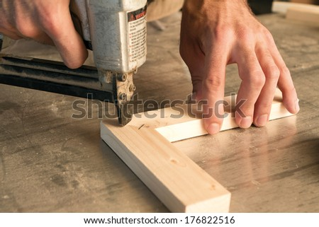 joinery uses a nail gun to attach pieces of wood