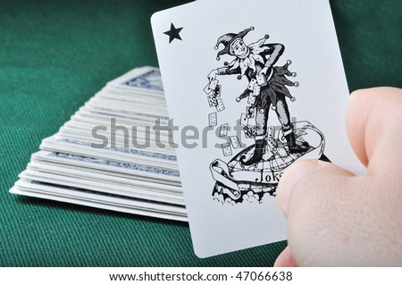 Joker in hand - stock photo