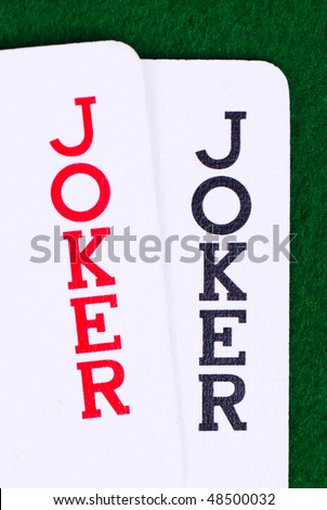 Jokers on green, closeup - stock photo