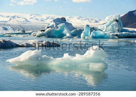 Jokulsarlon glacier Lagoon single small iceberg swimming on a lake