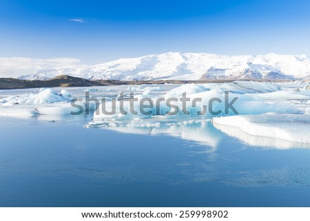 Jokulsarlon Glacier Lake In South Iceland With Clear Blue Sky - stock photo