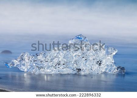 Jokulsarlon Ice in morning sun lights on sea beach, Iceland, - stock photo