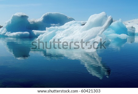 Jokulsarlon, Iceland - Mid summer. melting icebergs from vatnajokull glacier floating in Jokulsarlon lagoon - stock photo
