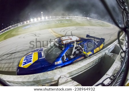 Joliet, IL - Jul 19, 2014:  Chase Elliott (9) takes the checkered flag for the third time this year as he wins the EnjoyIllinois.com 300 at Chicagoland Speedway in Joliet, IL. - stock photo