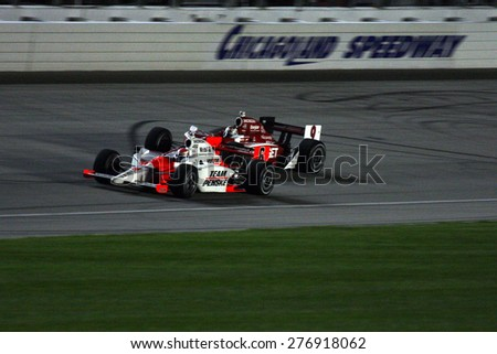 Joliet Illinois, USA - August 29, 2009: IndyCar Racing League. Nighttime Race action on track, cars running wheel to wheel, Chicagoland speedway.  Peak Antifreeze & Motor Oil Indy 300 - stock photo