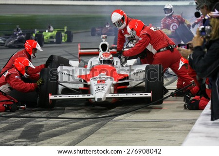 Joliet Illinois, USA - August 29, 2009: IndyCar Racing League. Pit stop during the race. Ryan Brisco driver for Penske racing. Team changes tires and fuels the car. Chicagoland speedway. Night Racing - stock photo