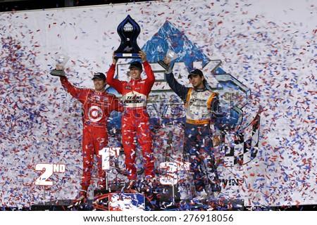 Joliet Illinois, USA - August 29, 2009: IndyCar Racing. Victory Circle Podium - Scott Dixon 2nd, Ryan Brisco, winner, Mario Moraes 3rd,  Chicagoland speedway.  Peak Antifreeze and Motor Oil Indy 300 - stock photo