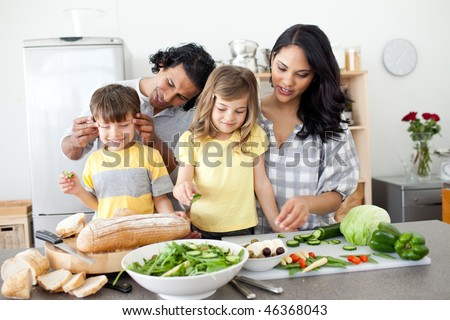 Jolly family preparing lunch together in the kitchen