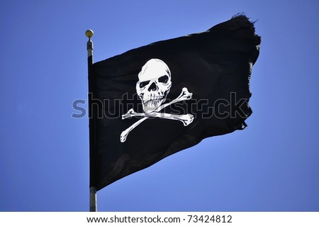 Jolly Roger - Flag of a Pirate skull and crossbones - stock photo
