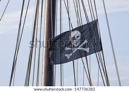 Jolly Roger, the pirate flag - stock photo
