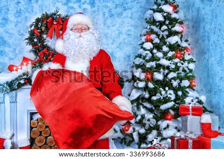 Jolly Santa Claus brought the sack with gifts. Christmas interior decoration. Merry Christmas. - stock photo