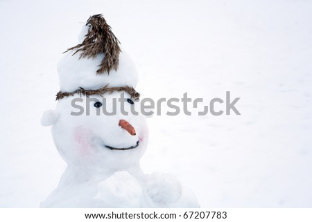 jolly snowman on the background of snow-covered field - stock photo