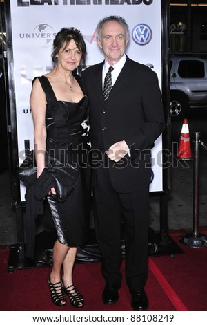 "Jonathan Pryce & date at the world premiere of his new movie ""Leatherheads"" at Grauman's Chinese Theatre. March 31, 2008  Los Angeles, CA Picture: Paul Smith / Featureflash"