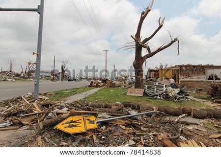 JOPLIN, MISSOURI - MAY 22: A school crosswalk sign lay amid rubble left behind as the deadliest US tornado since 1949 caused massive destruction as it swept through Joplin, Missouri on May 22, 2011
