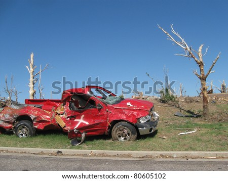 "JOPLIN, MO - JUNE 22:  Truck destroyed by the Joplin EF-5 tornado on May 22, 2011.  The ""x"" shows that search and rescue crews have searched the vehicle. - stock photo"