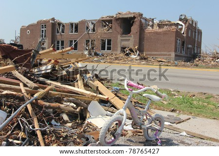 JOPLIN, MO - MAY 22: The ruins of an elementary school in Joplin, Missouri stand testament to the power of the tornado that cut a path of destruction 7 miles long and a half mile wide on May 22, 2011. - stock photo