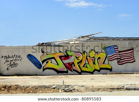 JOPLIN, MO, USA--JULY 12:  Graffiti decorates the walls of buildings that were destroyed by the EF-5 tornado that struck Joplin, MO on May 22, 2011.