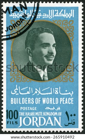 JORDAN - CIRCA 1967: A stamp printed in Jordan shows Portrait of King Hussein of Jordan (1935-1999), series Builders of World Peace, circa 1967 - stock photo