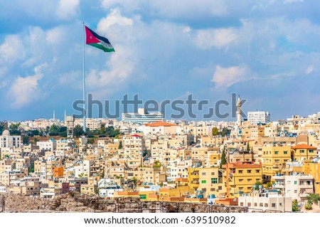 stock-photo-jordan-flag-in-amman-cloudy-
