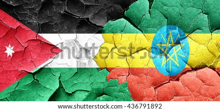 Jordan flag with Ethiopia flag on a grunge cracked wall - stock photo