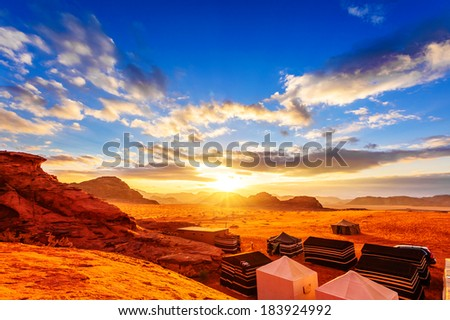 Jordanian desert at sunset in Wadi Rum, Jordan. Wadi Rum is known as The Valley of the Moon and a UNESCO World Heritage Site. - stock photo