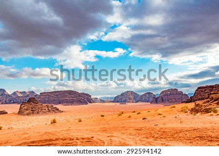 Jordanian desert in Wadi Rum, Jordan. Wadi Rum is known as The Valley of the Moon and has led to its designation as a UNESCO World Heritage Site.