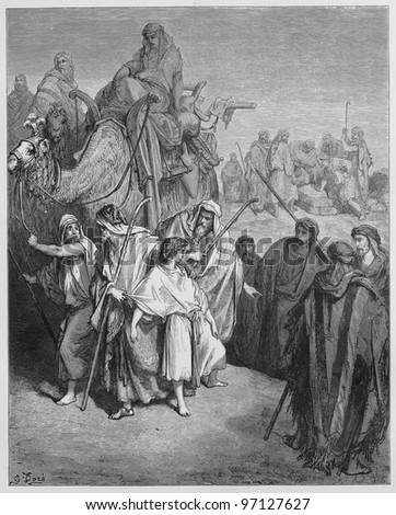 Joseph is sold Into slavery by his brothers - Picture from The Holy Scriptures, Old and New Testaments books collection published in 1885, Stuttgart-Germany. Drawings by Gustave Dore. - stock photo